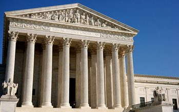 Washington state anti-discrimination laws remain intact despite the U.S. Supreme Court's decision to side with a Colorado bakery owner this week for refusing to serve a same-sex couple. (Davis Staedtler/Flickr)