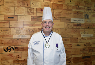 Chef Robert Anderson with the Iowa Culinary Institute at Des Moines Area Community College is a recipient of the L'Ordre des Palmes Academiques award from the French Republic. (dmacc.edu)