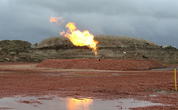 A recent study found methane flaring from oil and gas operations is 60 percent higher than previously thought. (gfpeck/Flickr)