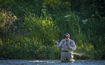 Summer fly-fishing in Montana could be under threat from rising temperatures because of climate change. (Preston Keres/U.S. Dept. of Agriculture)