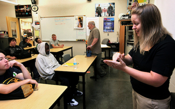 Paraeducators perform a range of tasks to help teachers in the classroom, including signing for students with hearing impairments. (Ellen Banner)
