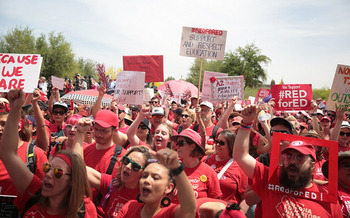 An estimated 50,000 teachers marched to the Arizona Capitol last spring to demand more public education funding. (Arizona Education Association/Flickr)