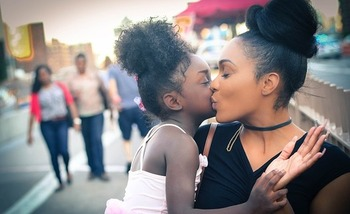 A new report finds that young parents of color face additional challenges as they work to raise their children and stay ahead financially. (Max Pixel)