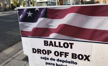 Voters who registered with The League of Women Voters' Omaha chapter will receive the last of three texts from the group as a reminder to go to the polls today and the location of their polling place. (Galatas)