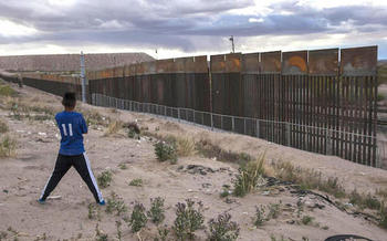 Only portions of the almost 2,000-mile long southern border between the United States and Mexico currently are separated by a wall. (keranews.org)
