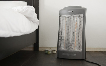 Space heaters should be limited to one per room to avoid overloading a home's electrical system. (yourbestdigs.com/Flickr)