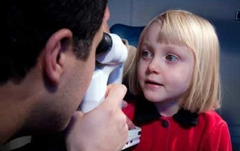 An eye examination from a pediatric ophthalmologist is a first step for parents of young children to determine any vision deficits. (NationalEyeInstitute/NIH)