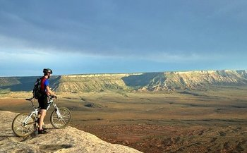 A mountain biker surveys the terrain on the Gooseberry Mesa National Recreation Trail in southern Utah. (Wikimedia Commons)