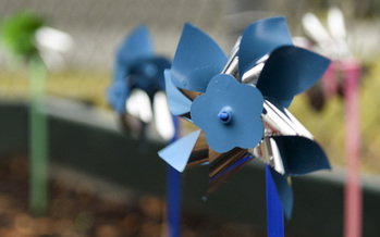 Blue pinwheels are the symbol for child-abuse prevention. (Airman Shawna Keyes/Wikimedia Commons)
