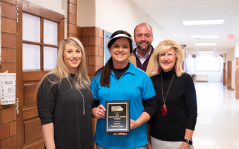 Lashonda Cooper, center, cafeteria manager at Simons Middle School, received the Rising Star Award in the Kentucky School Breakfast Challenge. (Ashley Lauren Photography)