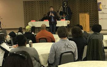 Igor Volsky with the group Guns Down America spoke at a town hall meeting Monday night in Flint. (Sam Inglot/Progress Michigan)