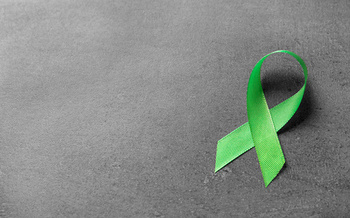 Green ribbons are the symbol for Mental Health Awareness Month. (New Africa/Adobe Stock)