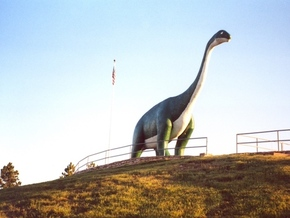 The apatosaurus, such as this concrete replica at Dinosaur National Park near Rapid City, roamed the state during the Mesozoic Era, 150 million years ago. (Wikimedia Commons)