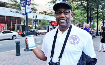 Ronald Ross holds an air-pollution monitoring device used in the AirKeepers project. (Clean Air Carolina)