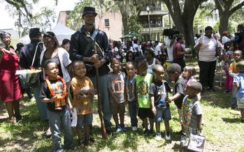 Union soldier re-enactor poses with children during Florida's Emancipation Day Celebration on May 20, 2015, at the Knott House Museum in Tallahassee. (Florida Memory)