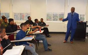Studies show that the presence of African-American male teachers in schools improves graduation rates for their black male students. (Shaitra Ken)