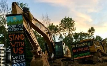 Banners hang from the site of a protest against the Mountain Valley Pipeline, where a protester was arrested on Wednesday for obstructing construction. (Appalachians Against Pipelines)