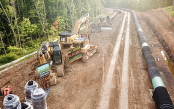A protester was arrested Wednesday after he locked himself to excavating equipment at this West Virginia site of the Mountain Valley Pipeline. (Appalachians Against Pipelines)