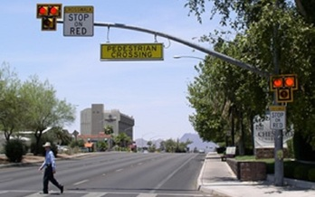 A Traffic HAWK (High-intensity Activated crossWalK beacon) installed on a Phoenix street makes crossing the road safer for pedestrians. (City of Phoenix)