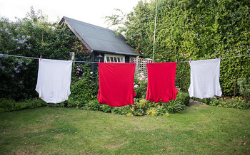 Hang drying clothes is an environmentally friendly alternative to power hungry dryers. (directline.com/Flickr)