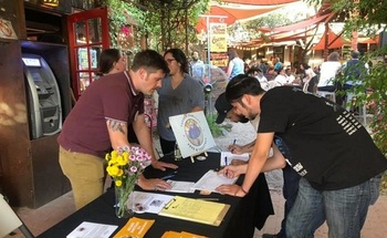 Immigration advocates gathered more than 18,000 signatures to put an initiative on the November ballot to make Tucson a