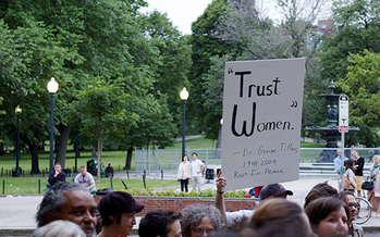 Protesters in Boston denounce anti-abortion violence, holding a sign to honor Dr. George Tiller, an abortion provider who was murdered in Kansas in 2009. (Tim Pierce/Wikipedia)