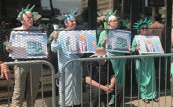 Four members of ElderWitness were arrested by DHS on charges of obstructing the entrance to a federal building.  (Roz Dutton/ElderWitness)