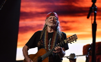 Willie Nelson, shown above at Farm Aid 2018, organized the first Farm Aid along with Neil Young and John Mellencamp in 1985. (Brian Bruner/Bruner Photo)