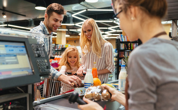 More than 60% of workers at grocery stores are women, according to the Oregon AFL-CIO. (Drobot Dean/Adobe Stock)