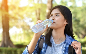 In addition to providing easy access to clean water, bottle-filling stations can help cut down kids' consumption of sugary beverages. (Adobe stock)