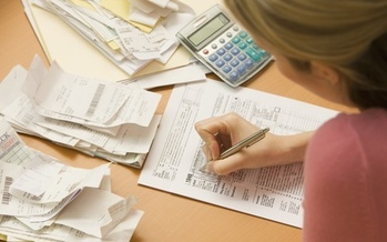 Free income tax preparers can help Michigan residents determine if they're eligible for the Earned Income Tax Credit and other credits. (Adobe Stock)