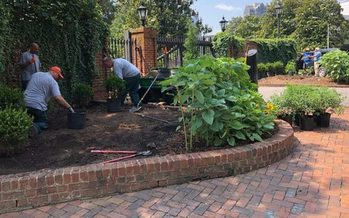 Gardeners work to plant an ozone garden in front of the Governor's Mansion in Raleigh. (Clean Air Carolina)