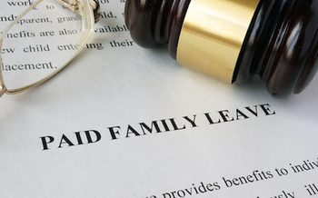 Washington state lawmakers approved a paid family and medical leave program in 2017. (designer491/Adobe Stock)
