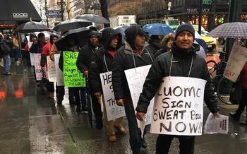 Workers rallying at Gov. Andrew Cuomo's Manhattan office say some employers still get away with wage theft. (NMAS)
