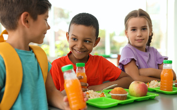 Many parents aren't aware of free school breakfast, after-school and summer meal programs. (New Africa/Adobe Stock)