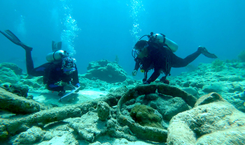 Divers Rebecca Hunter-Wimberley, left, and Ayeta Heatley recording in situ (meaning