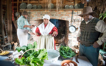 Left to right, Dontavius Williams, Nicole Moore, and Terry James, historical reenactors at Lexington County Museum in Lexington, South Carolina. Photo from Slave Dwelling Project. (Joe McGill)<br />