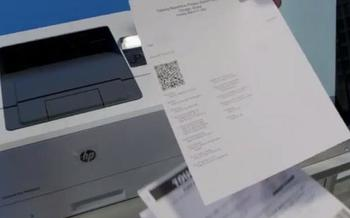 New voting machines being used in Cook County use a QR code for the voting audit paper trail. (Chicago Board of Elections Commissioners)