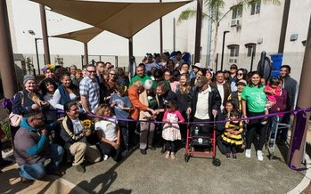 Residents cut the ribbon on Golden Age Park in Los Angeles in November. The park was built in part with funds from the AARP Community Challenge grant program. (Nacho Mora)