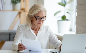Women face more challenges to saving money for retirement than men do. (fizkes/Adobe Stock)