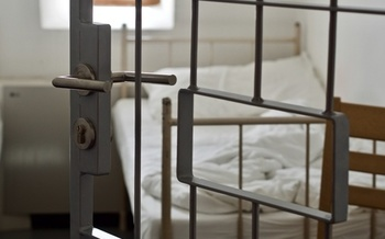 Criminal-justice groups say managing a highly contagious diseases such as coronavirus in prisons and detention centers is extremely difficult. (Adobe Stock)