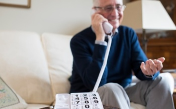 AARP Ohio volunteers are making friendly phone calls to fellow Ohioans who might feel isolated. (Adobe Stock)