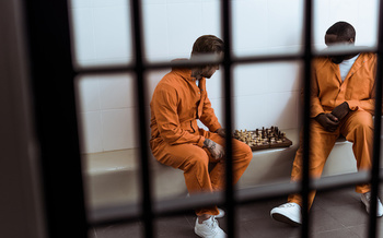 A one-week delay in reducing jail populations could mean 18,000 lives lost to COVID-19, according to a new report. (Lightfield Studios/Adobe Stock)