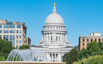 Wisconsin's COVID-19 relief bill was signed into law April 15. (Adobe Stock)