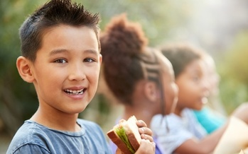 Summer meal sites help fill the gap for children in need of food when school isn't in session, and the pandemic won't change that this summer in Illinois. (Adobe Stock)