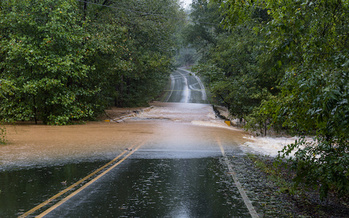 Rainwater from Hurricane Florence washes out a bridge in Waxhaw, North Carolina. (Adobe Stock)<br />