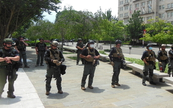 Law enforcement officers with no visible identification wait for protesters in downtown Washington, D.C., on Sat., June 6. (Wikimedia Commons)