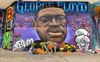 George Floyd murals, such as this one in Milwaukee, have surfaced across the globe following protests over his killing by Minneapolis police. (Graham Kilmer)