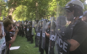 Demonstrators in Lafayette Park, across the street from the White House, square off against riot police on Tuesday. (Courtesy of Brandy Boyce)
