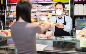 The United Food and Commercial Workers estimated that more than 9,000 grocery store workers in the United States were infected with the coronavirus as of May. (Adobe stock)